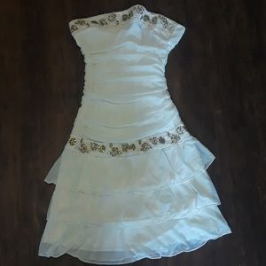Cream-colored dress with gold sequins trixxi